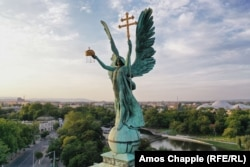 Budapest's Archangel Gabriel is depicted holding a cross and the holy crown of St. Stephen, Hungary's first king.