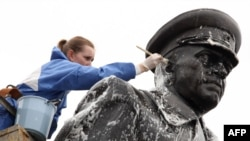 A municipal worker cleans a statue of Soviet World War II hero Marshal Georgy Zhukov in St. Petersburg in preparation for Victory Day festivities.