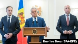 Democratic Party leaders Vladimir Plahotniuc (center), Andrian Candu (left), and Pavel Filip attend a press conference after meeting with the president in Chisinau on April 2, 2019.