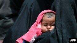 Ирактагы жергиликтүү аялдар. 26-май, 2017-жыл.