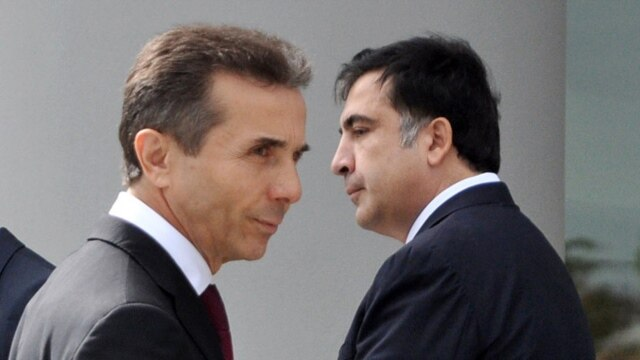 President Mikheil Saakashvili (right) and Prime Minister Bidzina Ivanishvili (file photo)