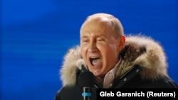 Президент России Владимир Путин на концерте-митинге в Москве, приуроченном к четвертой годовщине аннексии Крыма и проводимом в день президентских выборов. 18 марта 2018 года.