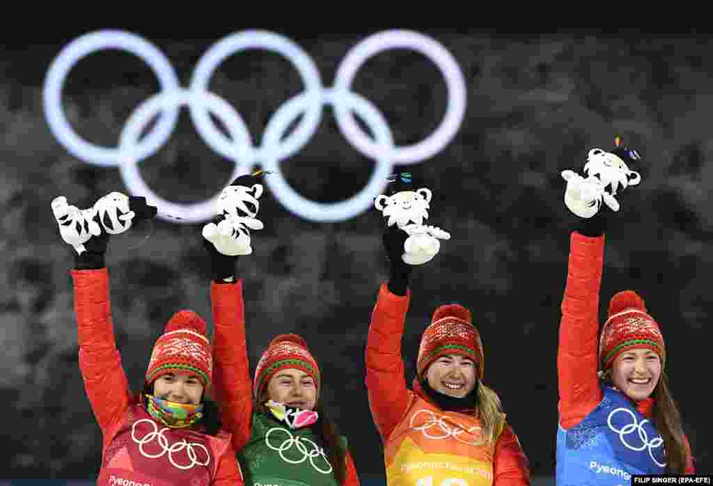 Biathlon: Gold medal winner team of Belarus (From left: Nadezhda Skardino, Iryna Kryuko, Dzinara Alimbekava, Darya Domracheva) react during the venue ceremony of the Women's Biathlon 4 x 6 km Relay race at the Alpensia Biathlon Centre during the PyeongChang 2018 Olympic Games, South Korea, February 22, 2018.