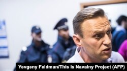 Russian opposition leader Aleksei Navalny attends a hearing in a Moscow court after being detained ahead of a rally in Nizhny Novgorod on September 29.