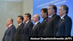 Leaders of the SCO countries pose for on June 14.