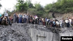 People gather at the site of an explosion in a coal mine in Golestan Province, in northern Iran on May 3.