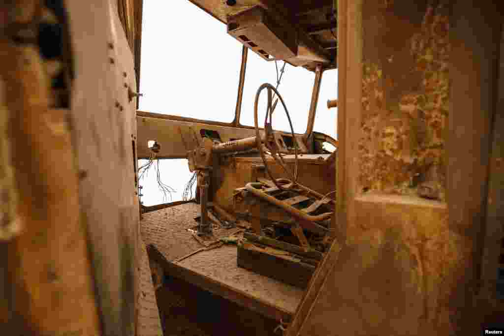 The burnt-out cab of a New York City Fire Department (FDNY) fire truck is seen inside the Memorial Museum.