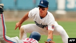 The Dodgers' Greg Gagne tags out a Montreal Expos baserunner during a 1997 Major League Baseball game.