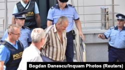 Gheorghe Dinca outside a courthouse in Craiova on July 27.