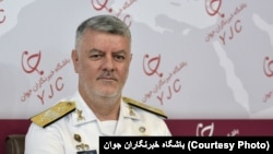 Rear Admiral Hossein Khanzadi, Iran's naval chief, said maneuvers with Russia and China will start in December.