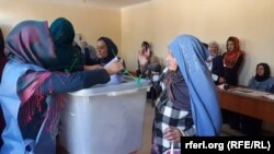 FILE: Afghan women voting during a parliamentary election in October 2018.