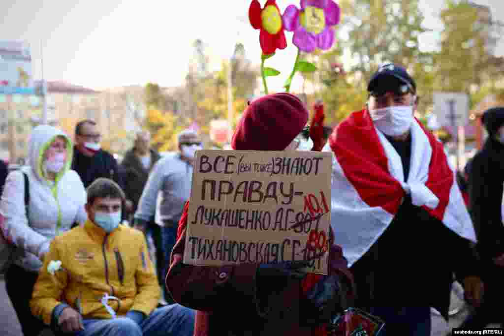 "Disabled people march during an opposition rally in Minsk on October 22. The poster reads: ""Everybody (you, too) knows the truth."""