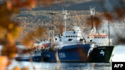 "Greenpeace's ""Arctic Sunrise""(right) is moored next to a Russian Coast Guard ship in the northern port of Murmansk."