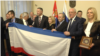 Serbia -- Belgrade -- Natalia Poklonskaya Deputy of the State Duma of Russian Federation with Bosko Obradovic founder and leader of the right-wing political party Dveri showing flag of Crimea in National Assembly of Republic of Serbia