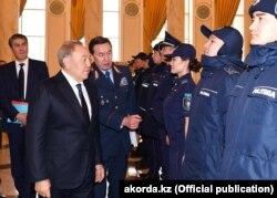 Президент Нұрсұлтан Назарбаев және президент кеңесшісі және қауіпсіздік кеңесінің хатшысы Қалмұханбет Қасымов