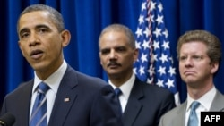 U.S. President Barack Obama speaks alongside Attorney General Eric Holder and Shaun Donovan (left to right), secretary of housing and urban development, in Washington in February.