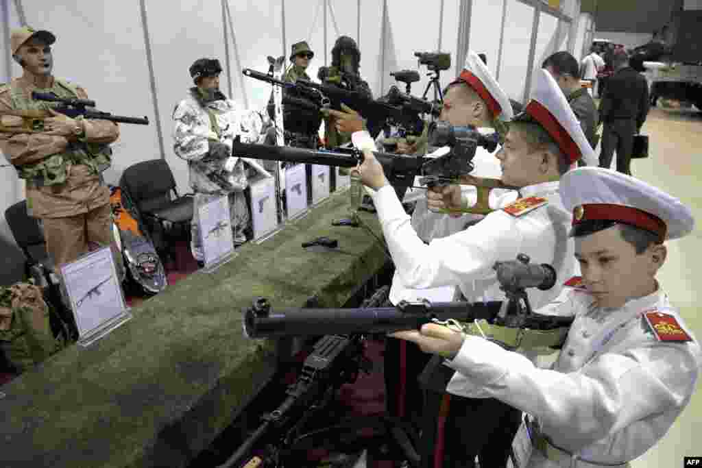 Russian military cadets check out weapons at a military exhibition in Rostov-on-Don. (AFP/Sergei Venyavsky)