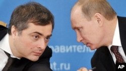 Russian Prime Minister Vladimir Putin, right, with his adviser Vladislav Surkov