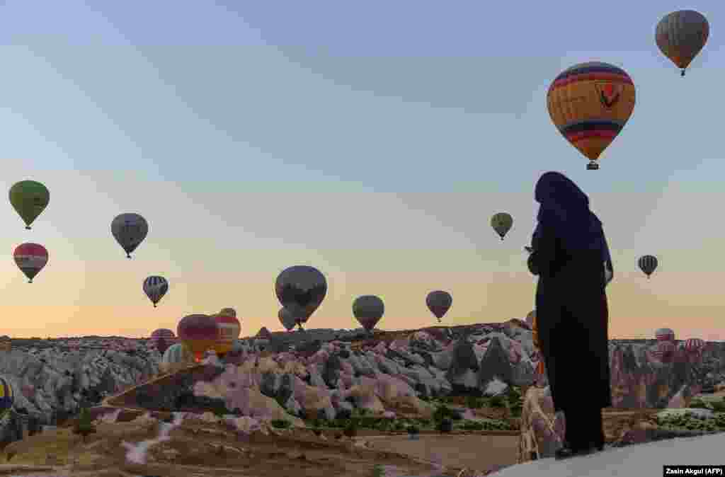 Hot air balloons glide during a flight over Nevsehir in Turkey's historic Cappadocia region on September 5. (AFP/Yasin Akgul)