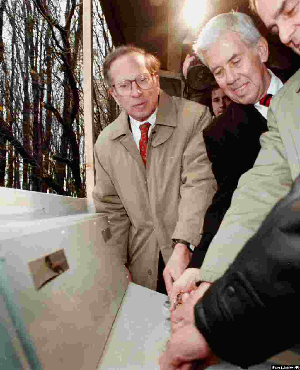 U.S. Senators Sam Nunn and Richard Lugar turn two tiny keys to initiate the destruction of a former Soviet nuclear missile silo in the formerly top-secret Khmelnitsky military base in central Ukraine on October 23, 1996. The keys once held the power to launch SS-19 missiles at the United States.