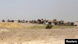 مقاتلون من قوات الحشد الشعبي في النباعي