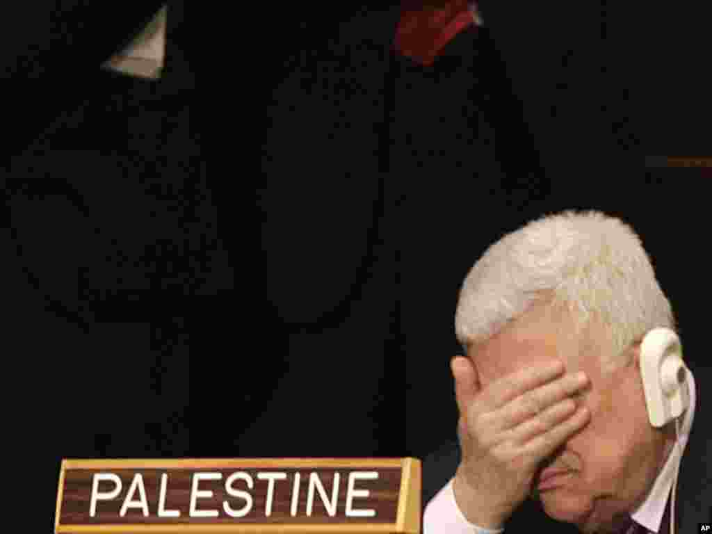 Palestinian leader Mahmud Abbas rubs his eyes during U.S. President Barack Obama's speech at the 66th session of the United Nations General Assembly in New York on September 21. (Photo taken by Seth Wenig for AP)