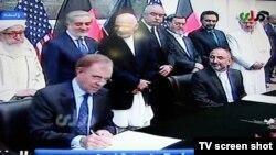 Видеокадр церемонии подписания соглашения о безопасности между США и Афганистаном. Кабул, 30 сентября 2014 года.