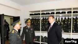 Azerbaijan -- President Ilham Aliyev inaugurates interior military camp, 24Sep2011
