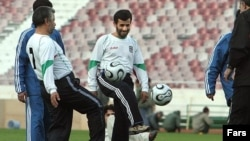 President Mahmud Ahmadinejad joins the national team in training in 2006.