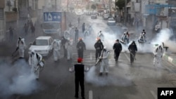 Iranian firefighters disinfect streets in a bid to halt the spread of coronavirus in Tehran on March 13.