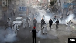 Iranian Firefighters disinfect streets in a bid to halt the spread of coronavirus, in Tehran, March 13 2020