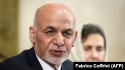 Afghan President Ashraf Ghani delivers a speech next to his wife, Rula Ghani during the United Nations Conference on Afghanistan at the UN Offices in Geneva on November 28.