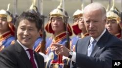 Mongolian Prime Minister Batbold Sukhbaatar (left) and U.S. Vice President Joe Biden
