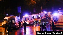 Police and ambulances arrive at the site of an explosion in central Istanbul on December 10.