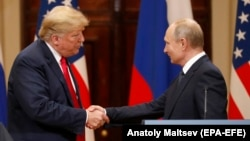 U.S. President Donald Trump (left) and Russian President Vladimir Putin shake hands following their talks in Helsinki in July.
