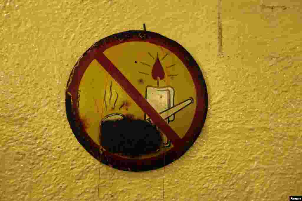 A sign banning open fires and smoking