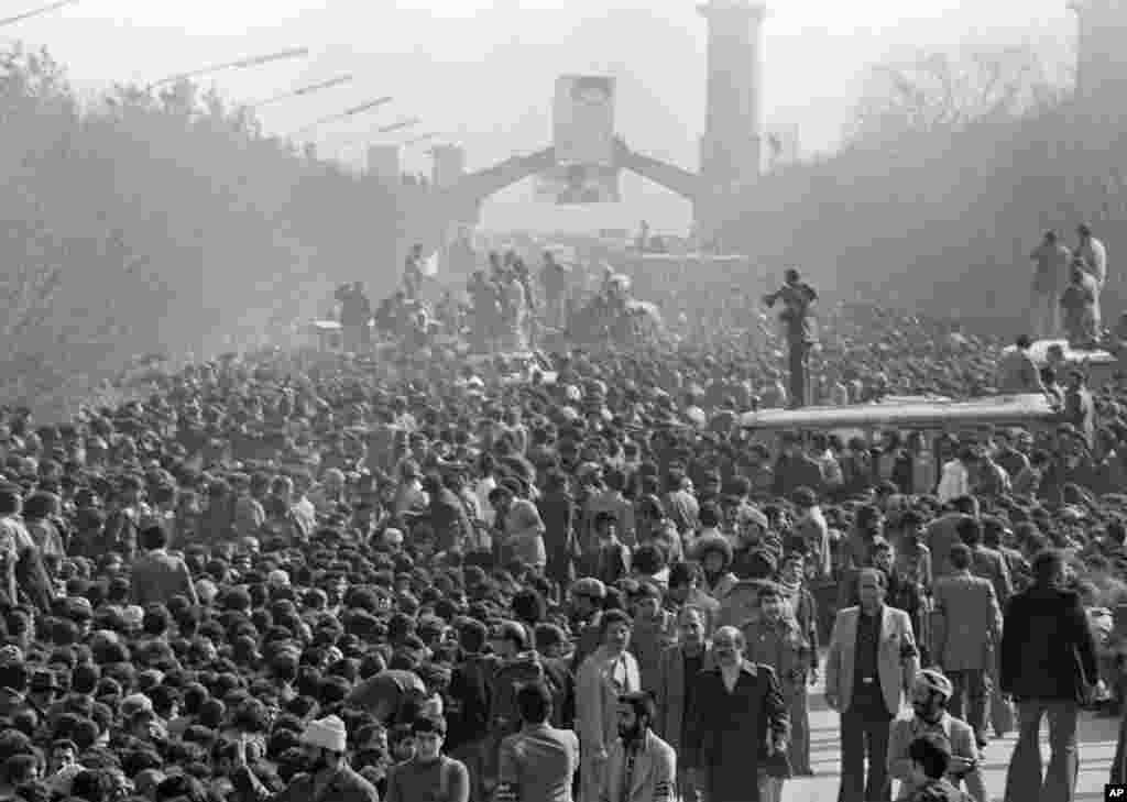 A crowd listens to Khomeini address them at Behesht-e Zahra cemetery. An estimated five million people gathered in Tehran to show support.