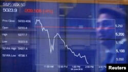 Australia -- Australia's S&P/ASX 50 Index shows a four per cent decline in afternoon trade after votes were counted in Britain's EU referendum at the Australian Stock Exchange in Sydney, June 24, 2016