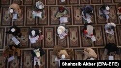 Pakistani and foreign religious students take exams at the Jamia Binoria Aalamia madrasah in Karachi.