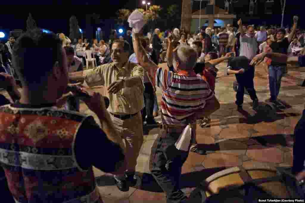 The last place Tufankjian visited for her project was Anjar, a village in Lebanon, the ancestral home of her great-grandparents and an area where Armenian cultural traditions are almost perfectly preserved. Here, local residents celebrate Surp Khach, or Holy Cross Day, with late-night dancing and eating.