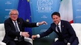 European Commission President Jean-Claude Juncker (left) and new Italian Prime Minister Giuseppe Conte at the G7 Summit at La Malbaie, Quebec, on June 8, 2018.