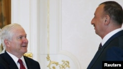 Azerbaijani President Ilham Aliyev (right) meets with U.S. Defense Secretary Robert Gates in Baku on June 6.
