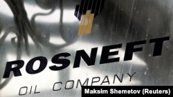 RUSSIA -- A logo of Russian state oil firm Rosneft is seen at its office in Moscow, October 18, 2012