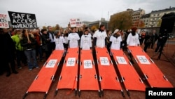 The staff of Medecins Sans Frontieres (MSF), also known as Doctors Without Borders, demonstrates in Geneva, November 3, 2015.