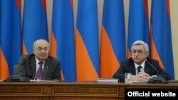 Armenia -- President Serzh Sarkisian (R) and chairman of the Public Council, Vazgen Manukian, hold a meeting in Yerevan, 14Mar2015