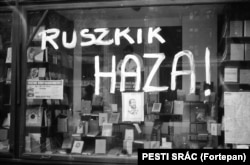 "A bookstore window scrawled with the phrase ""Russians go home!"" Hungarians fought bitter, deadly battles with Soviet troops inside the country during the uprising."