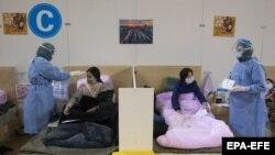 ارشیف، په چین کې په کرونا ویروس اخته ناروغان