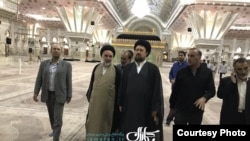 Hassan Khomeini, Ayatollah Khomeini's grandson, visits his grandfather's mausoleum after the attacks