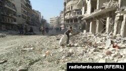 Алеппоның көтерілісшілер бақылауындағы аудандарына жасалған әуе шабуылдарынан кейінгі көрінісі. Сирия, 18 қазан 2016 жыл.