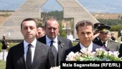 Some analysts fear that billionaire Bidzina Ivanishvili (right) may have something to do with tensions between Georgian Prime Minister Irakli Garibashvili (left) and the country's President Giorgi Margvelashvili (center -- file photo)